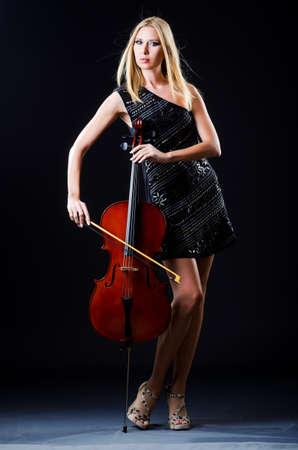 virtuoso: Woman playing cello on white