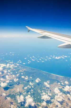 Airplane wing out of window Stock Photo - 15929217