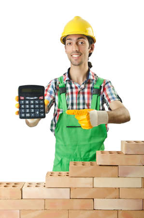 budget repair: Expensive construction concept with builder and calculator Stock Photo