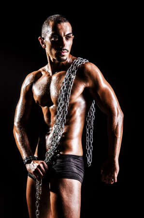 Bodybuilder with chains in dark Stock Photo - 15926633