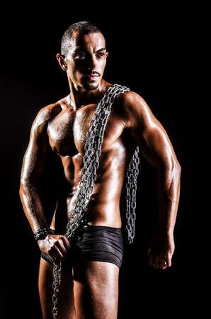 Bodybuilder with chains in dark Stock Photo - 15926633
