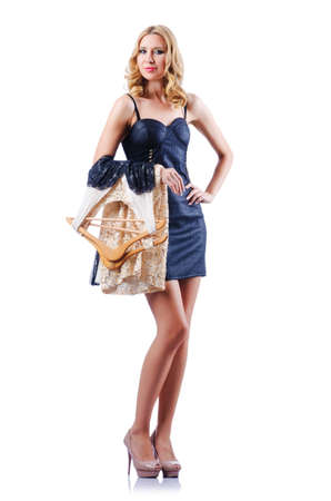 Woman trying new dresses on white Stock Photo - 15925002