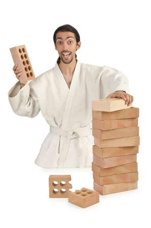 Karate man breaking bricks on white Stock Photo - 15925747