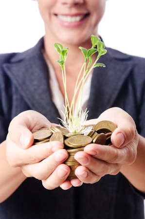 Businesswoman with seedlings and coins Stock Photo - 15926563