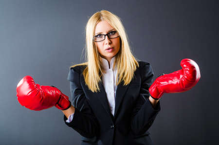 Woman boxer in dark room Stock Photo - 15926419