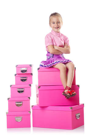 Little cute girl with lots of boxes Stock Photo - 15925851