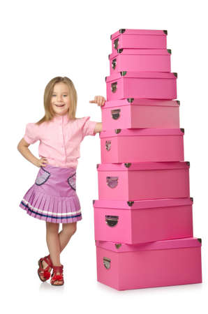 Little cute girl with lots of boxes Stock Photo - 15926336