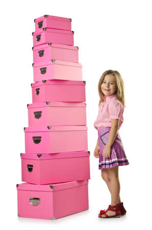 Little cute girl with lots of boxes Stock Photo - 15926135