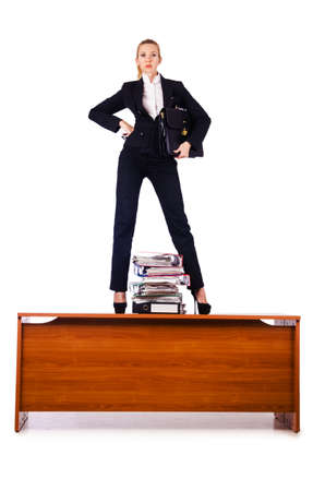 Dominant woman boss standing on desk photo