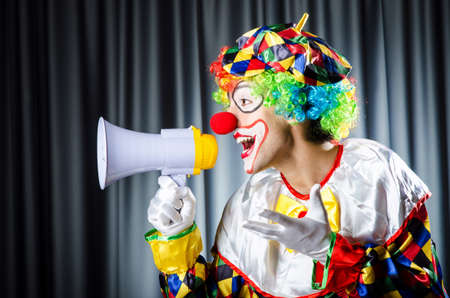 Clown in studio with loudspeaker photo