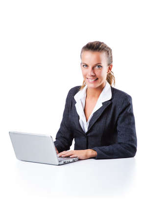 Young businesswoman working on laptop Stock Photo - 16174432