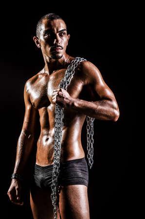 Bodybuilder with chains in dark Stock Photo - 16098812