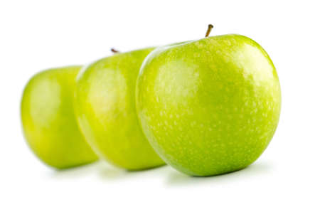 Green apples isolated on the white background photo