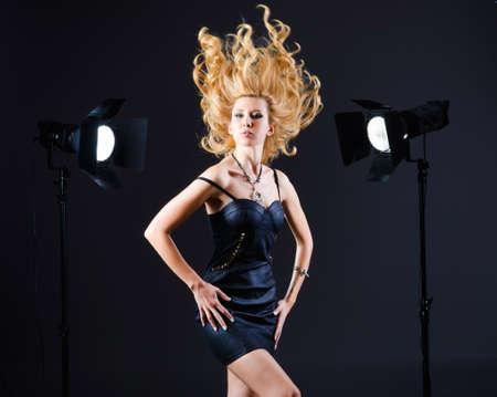 Attractive woman in studio shooting Stock Photo - 16064313
