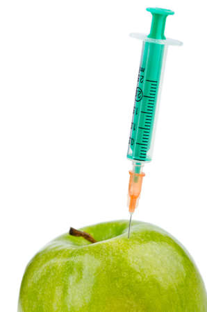Experiment with apple and syringes photo