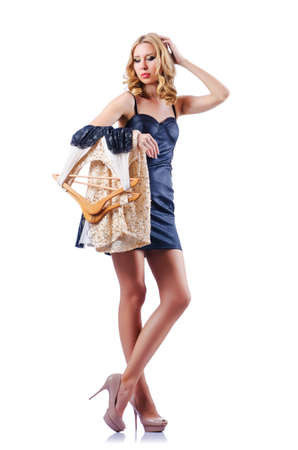 Woman trying new dresses on white Stock Photo - 16064435