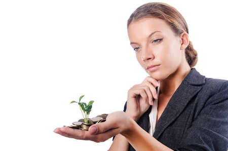 Businesswoman with seedling on white photo