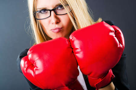 Woman boxer in dark room photo