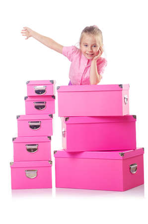 Little cute girl with lots of boxes Stock Photo - 16064369