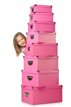 Little cute girl with lots of boxes Stock Photo - 16064366