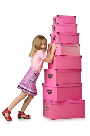 Little cute girl with lots of boxes Stock Photo - 16174453