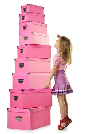 Little cute girl with lots of boxes Stock Photo - 16174502