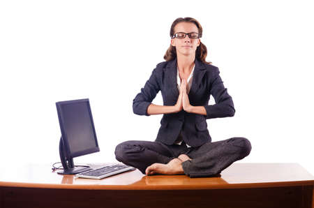 Woman meditating on the desk photo