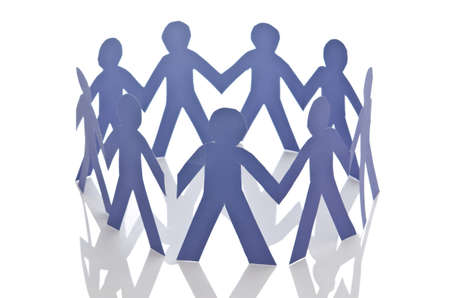 linked together: Teamwork concept with paper cut people Stock Photo