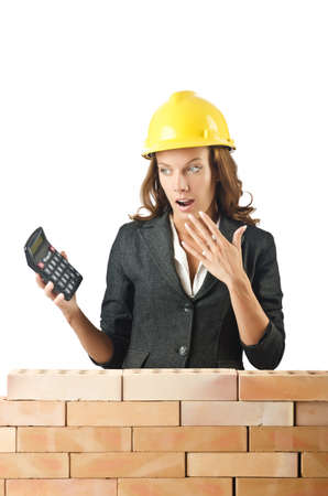 Expensive construction concept with woman photo