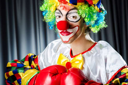 Funny clown in the studio shooting photo