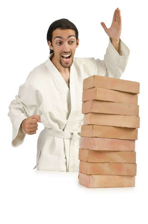 Karate man breaking bricks on white Stock Photo - 16178466