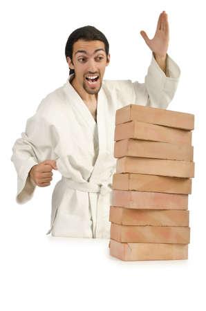 Karate man breaking bricks on white Stock Photo - 16178466