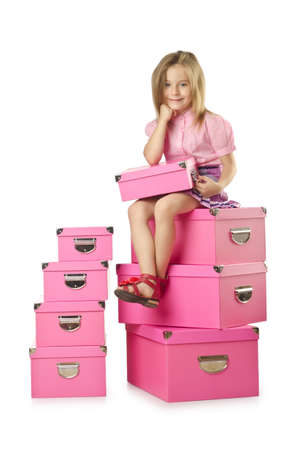 Little cute girl with lots of boxes Stock Photo - 16146082
