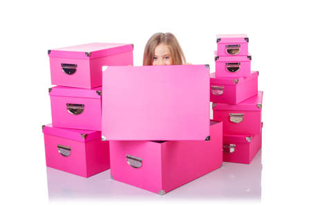 Little cute girl with lots of boxes Stock Photo - 16146080