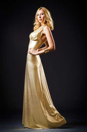Attractive woman in dark room Stock Photo - 16178538