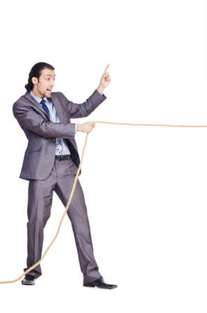 Businessman pulling rope on white photo