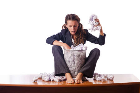 Woman with lots of discarded paper Stock Photo - 16178452
