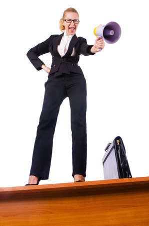 Businesswoman shouting through loudspeaker photo