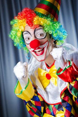 Funny clown in studio shooting photo