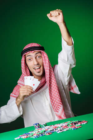 Arab playing in casino - gambling concept with man photo