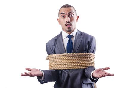 esclavo: Empresario atado con una cuerda Foto de archivo