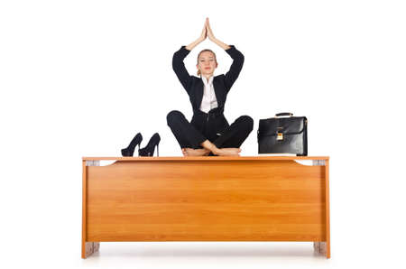Businesswoman meditating isolated on white photo