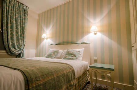 Hotel room with double bed Stock Photo - 16416076
