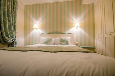 Hotel room with double bed Stock Photo - 16415771