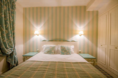 Hotel room with double bed Stock Photo - 16415904