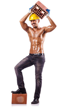 Muscular builder with bricks on white Stock Photo - 16475868