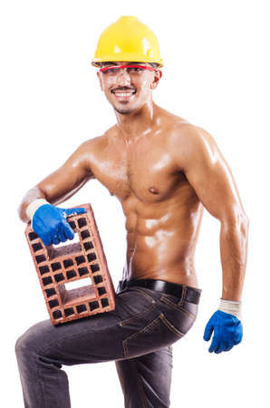Muscular builder with bricks on white Stock Photo - 16476056