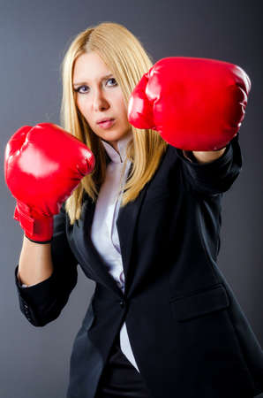 Woman boxer in dark room Stock Photo - 16483095