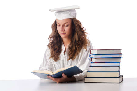 Happy graduate with lots of books on white Stock Photo - 16475906