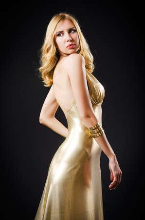 Attractive woman in dark room Stock Photo - 16476067